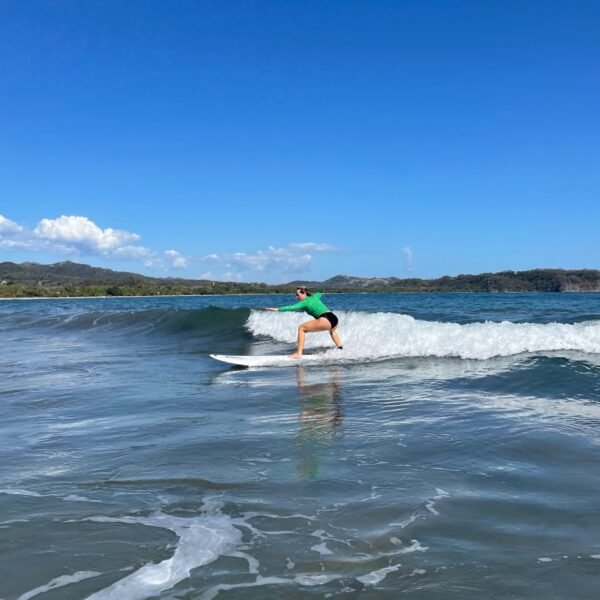 Paige learns to surf in Costa Rica