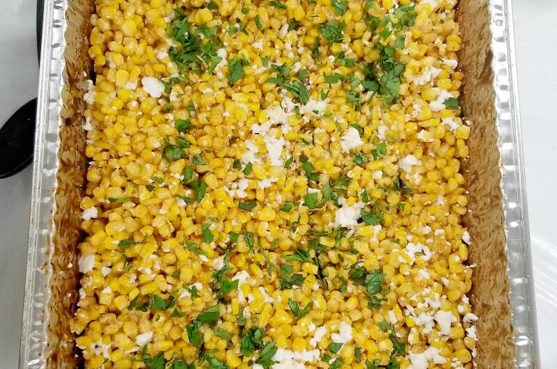 Mexican Street Corn casserole for a crowd in an aluminum hotel pan