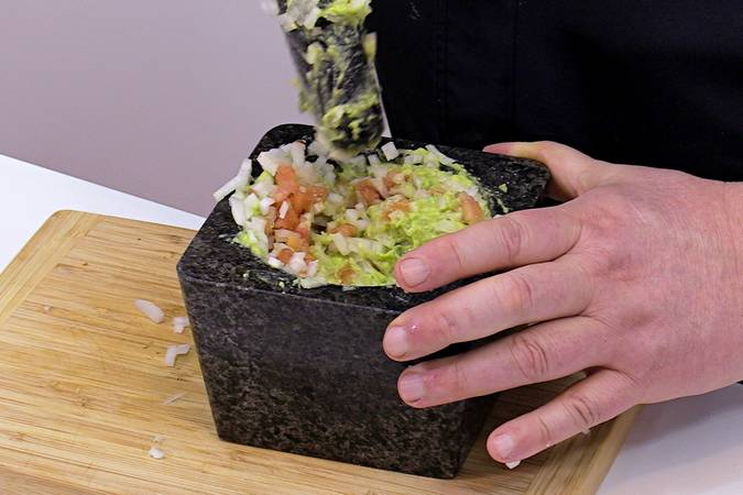 Add the chopped onion to the homemade guacamole