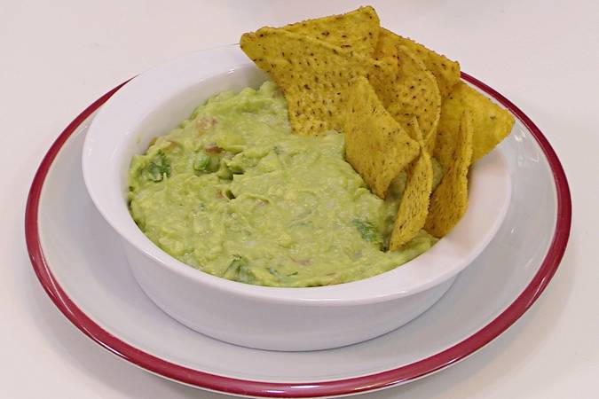 Take the guacamole out of the fridge and present it