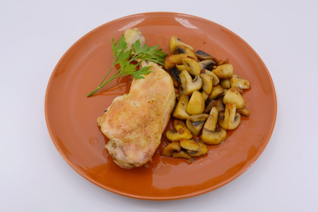 Roast chicken in the oven with mushrooms