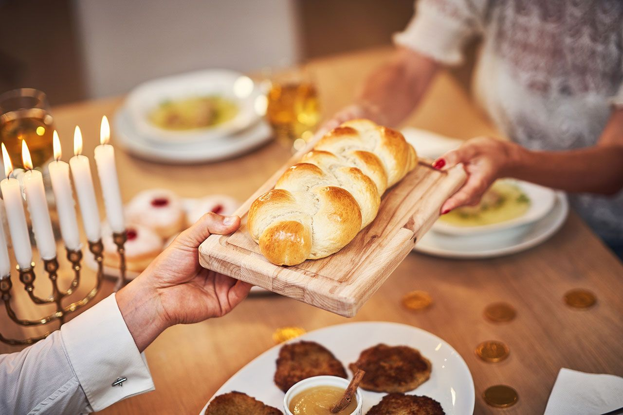 Challah knitted bread on a Jewish religious holiday