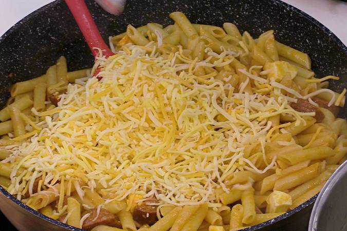 Add the cooked pasta and add the cheese