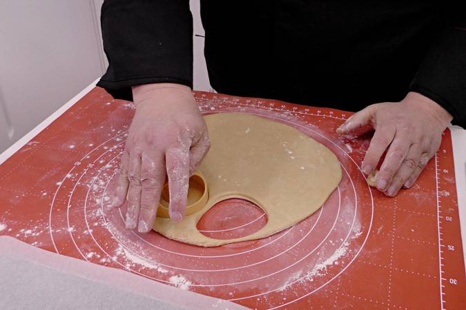 Cut the dough into donuts