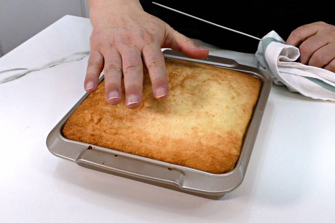 Step 6 of peach pudding in sponge cake syrup