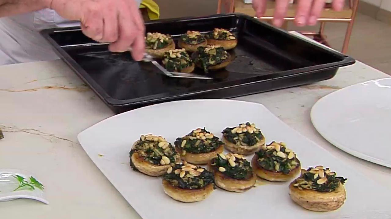 Mushrooms stuffed with spinach and pine nuts