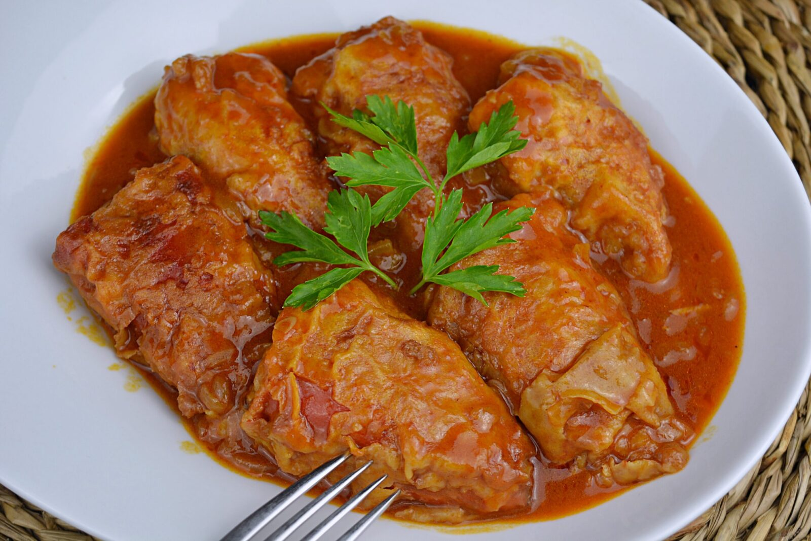 Peppers stuffed with meat with tomato sauce