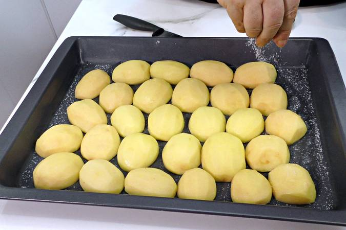 Place the potatoes on the pan