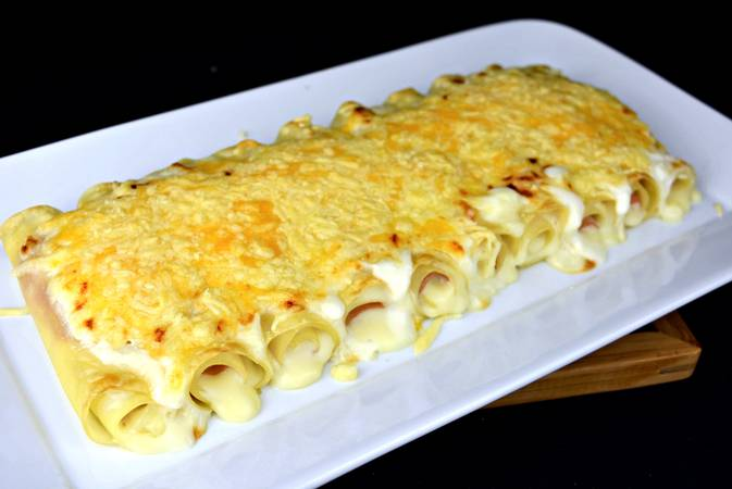 Step 7 of lasagna with ham and gratin cheese