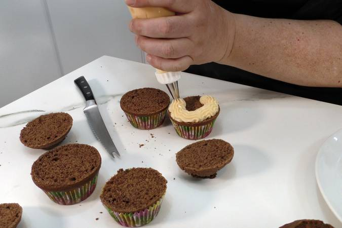 Step 9 of chocolate cupcakes filled with white chocolate cream