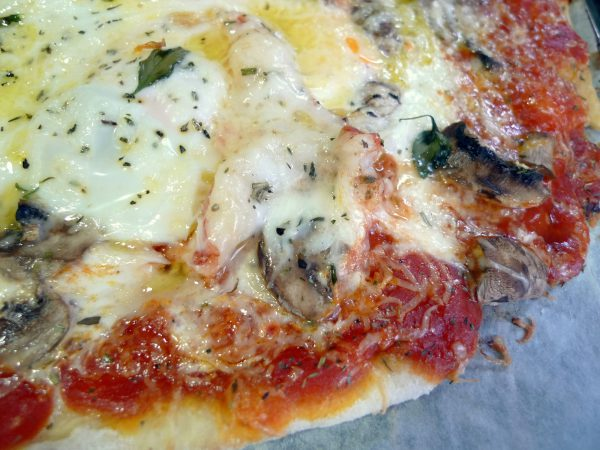 Pizza with chicken, mushrooms and eggs