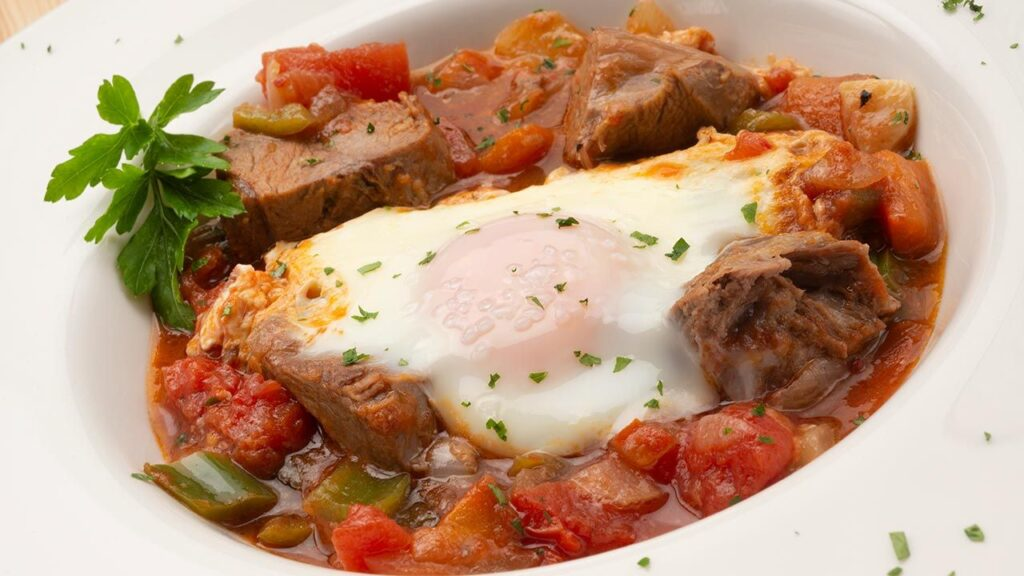 Recipe for cooked meat with fried and eggs on a plate - Karlos Arguiñano