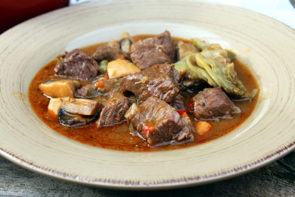 Meat stew with artichokes and mushrooms