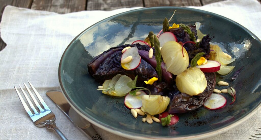 Roasted red cabbage and wild onions with wild asparagus and pine nuts