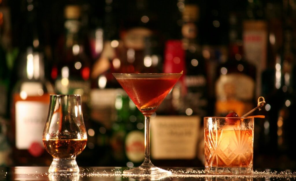 Santa Lucia rum, cocktail glass with Manhattan and shallow glass with tequila
