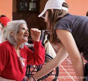 Sara McDaniel with Guatemalan elderly woman, a better life