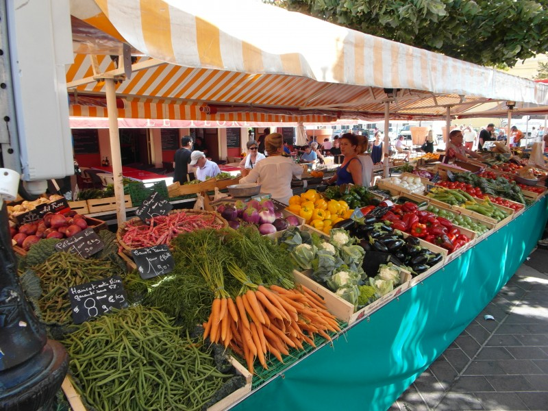 Vegetable stand at the Marche aux Fleurs (Flower Market) of Cours Saleya in Nice