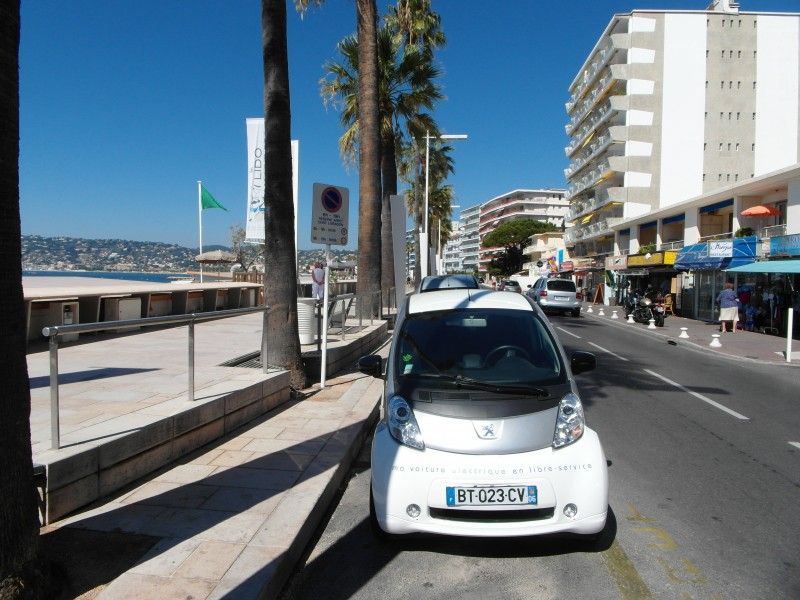 Antibes : Our Auto Bleue electric car on the beachfront in Juan Les Pins