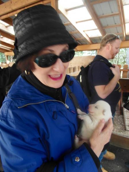 Lynn cuddling a nine-day old Alaskan puppy dog! - Skagway Alaska