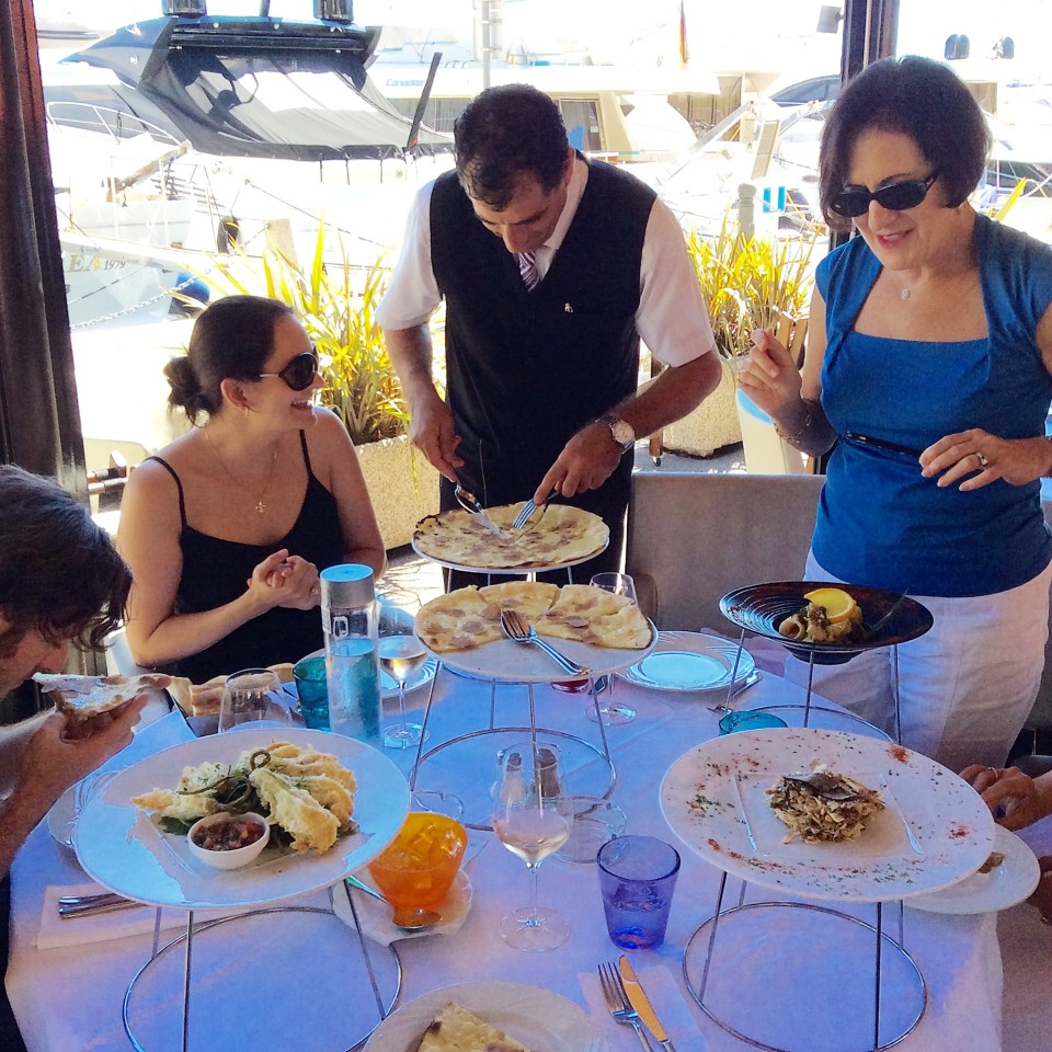 Serving the White Truffle Pizza at African Queen restaurant in Beaulieu-sur-Mer