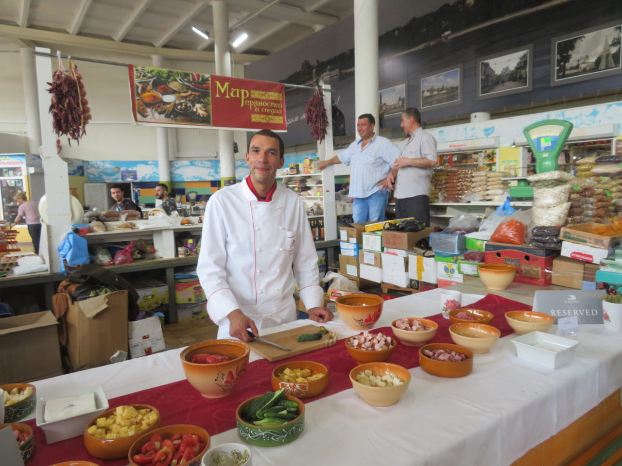 Sampling local fresh vegetables at the Yaroslavl fresh food market, under the guidance of Viking Akun Executive Chef Danilo
