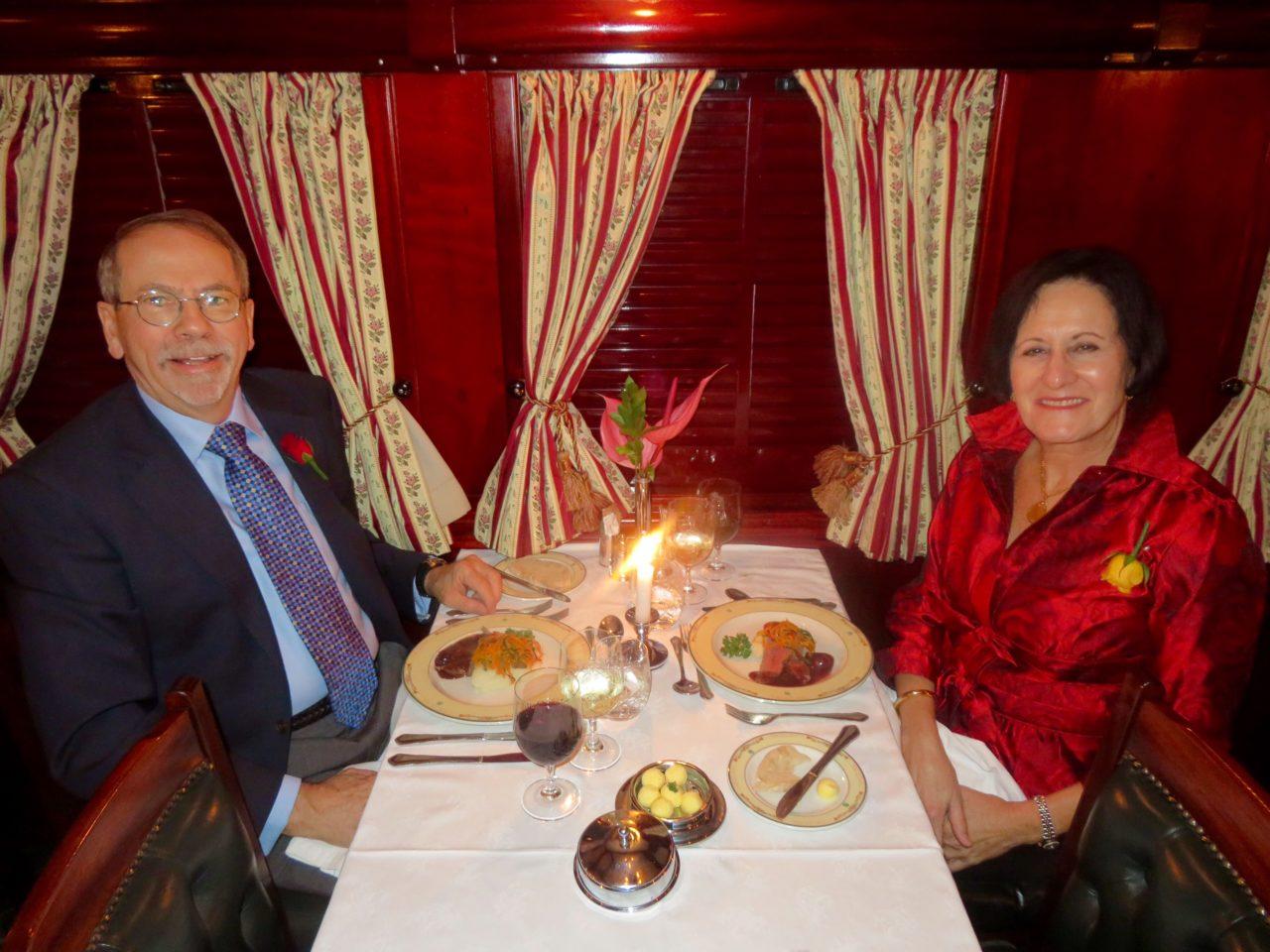 Denis and Lynn enjoying fine dining aboard<strong> Rovos <em>Rail</em></strong>