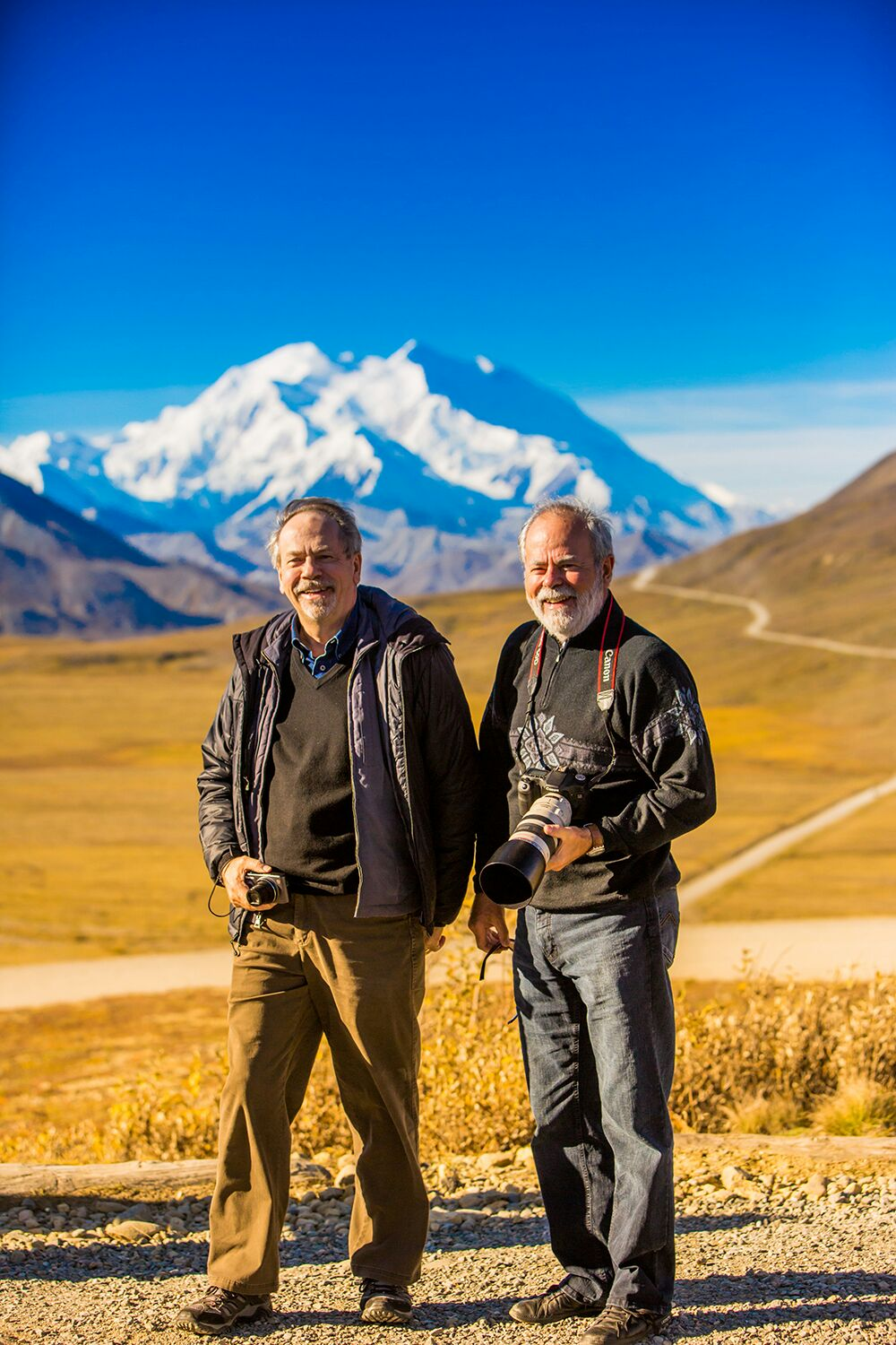 """Denis and Louis-Simon in Mount Denali National Park in Alaska (photo by photographer Laura Grier of <a href=""""http://www.lauragrier.com/"""">LauraGrierTravel</a>)"""