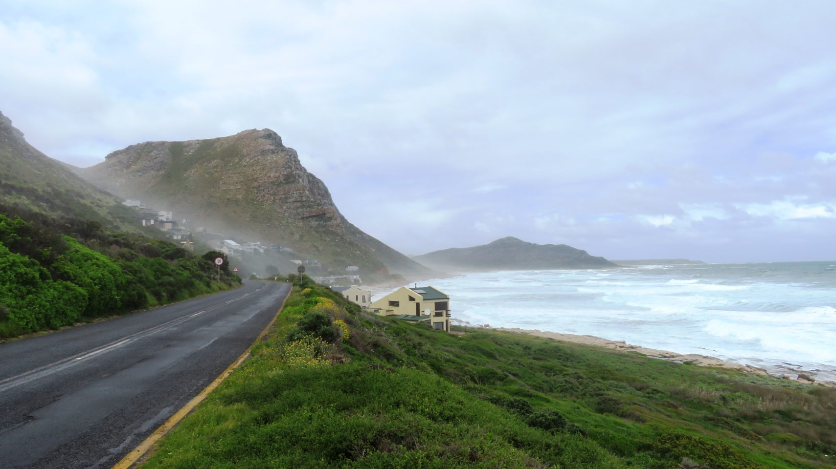 """Aptly named """"Misty Cliffs"""", this fishing village nestled in the hillside with its rockeries, wild flowers and wild ocean is quintessential Cape Peninsula"""