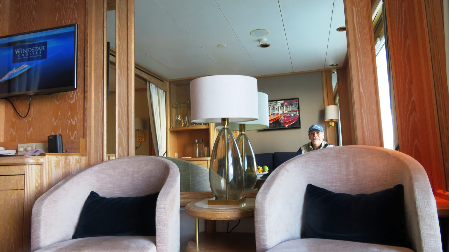 Windstar Cruises ~ Denis enjoying the comfort of the living area of our ideal cabin