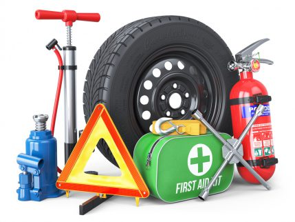 A set of automotive accessories. Spare wheel, fire extinguisher, first aid kit, emergency warning triangle, jack, tow rope, wheel wrench, pump. Objects isolated on white background. 3d