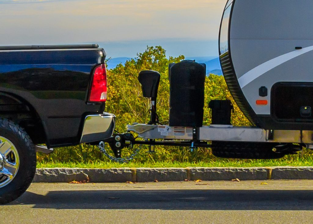 Jonas Ridge, NC, USA-16 October 17:  A Ram 2500 pickup towing a Camplite 16DBS travel trailer at an overlook on the Blue Ridge Parkway.
