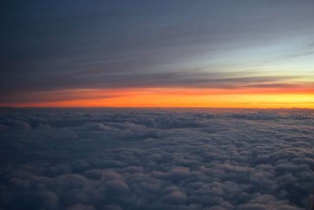 Sunrise from the window of my United flight into CDG