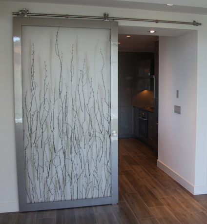 modern 3Form laminate barn door with stainless steel hardware