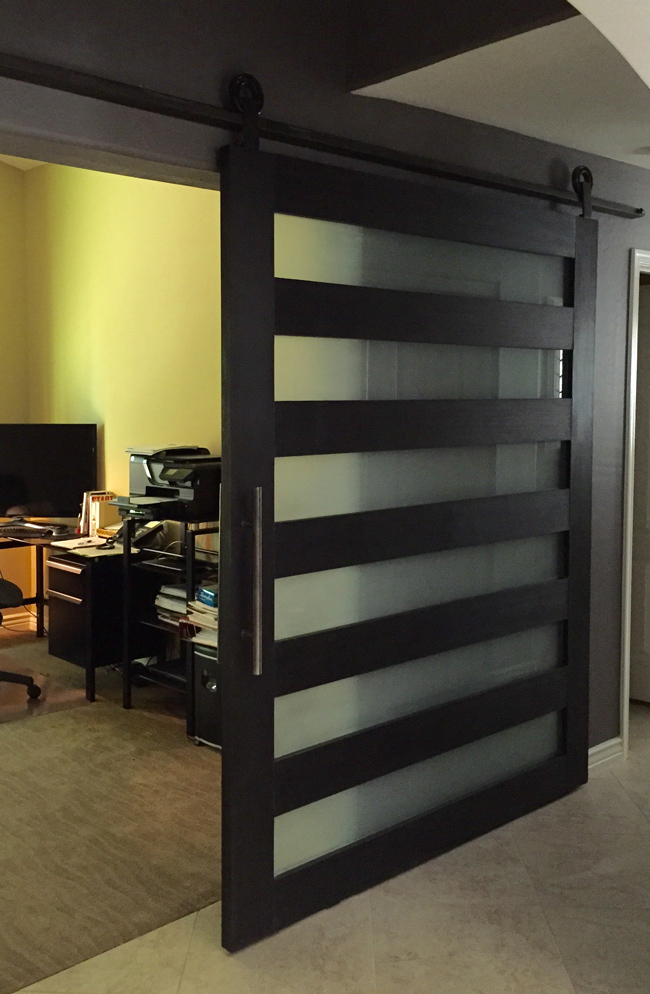 contemporary wood and satin frosted glass barn door