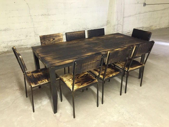 industrial iron and charred wood table and chairs