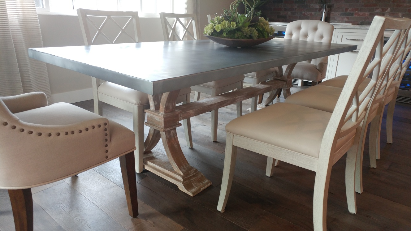 zinc table top with trestle wood legs