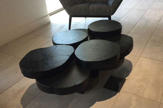 charred log coffee table