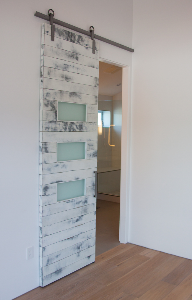 weathered white barn doors with satin glass