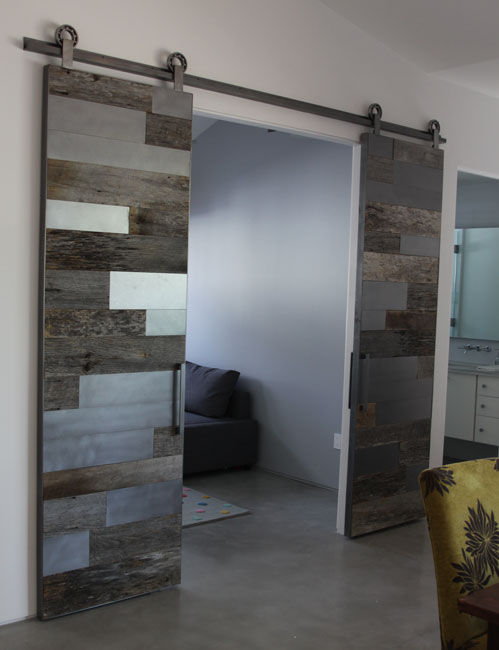 gray barn wood and satin steel metal panels barn door