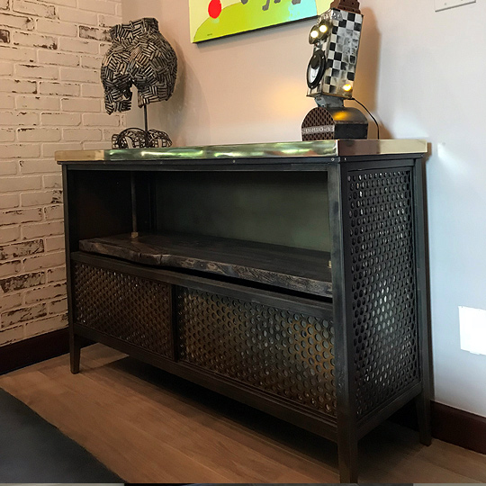 perforated credenza with wood shelve and glass top with bullet shells