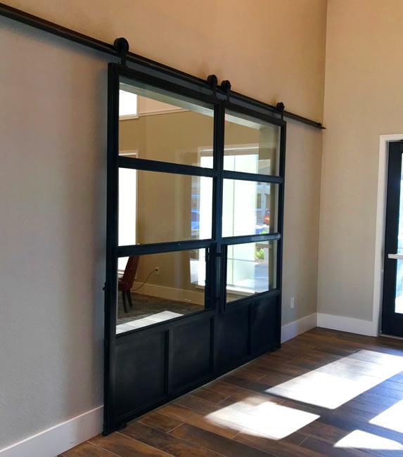 double patina steel and glass barn doors