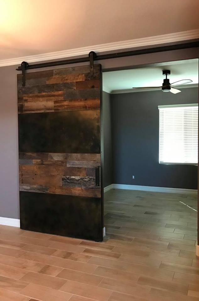 patina metal and reclaimed barn wood barn door