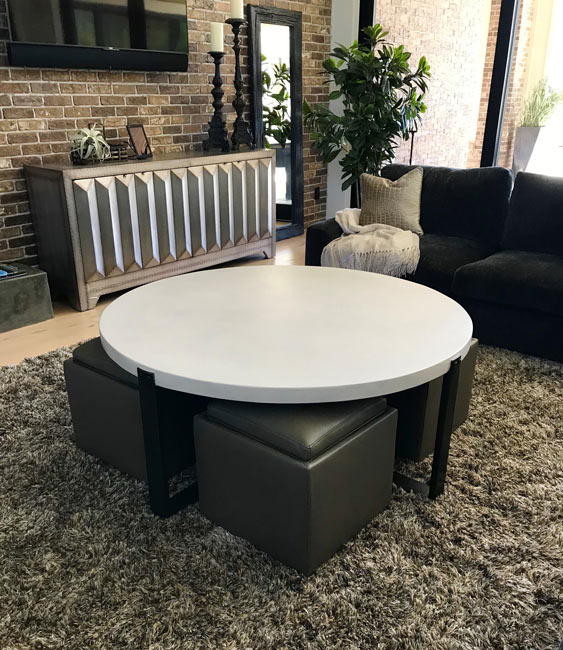 x metal base with round white concrete top