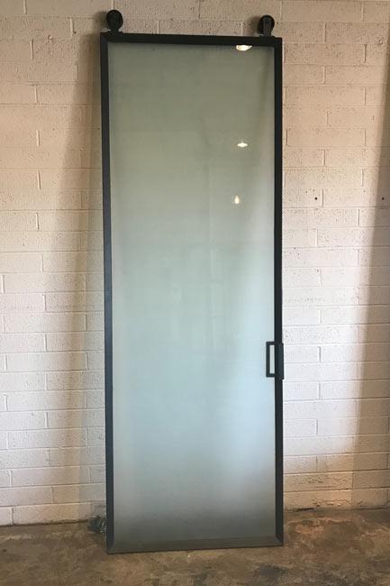 satin glass and metal barn door