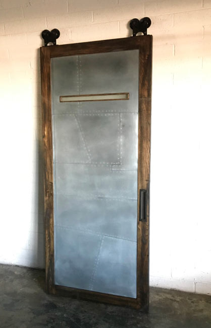 random pattern zinc and wood barn door with window
