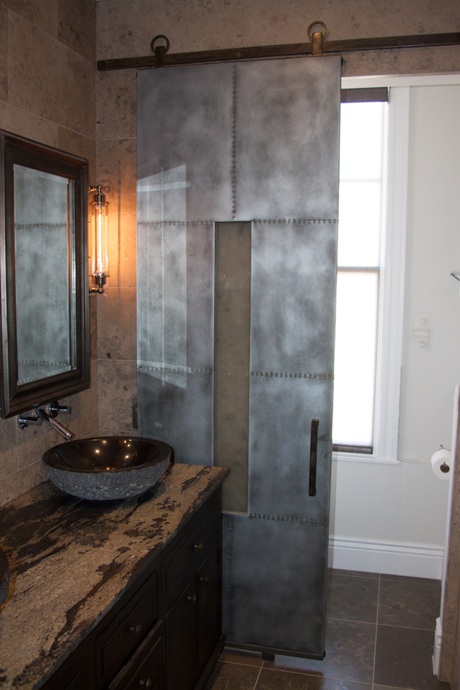 zinc with small rivets and opaque glass bathroom sliding barn door