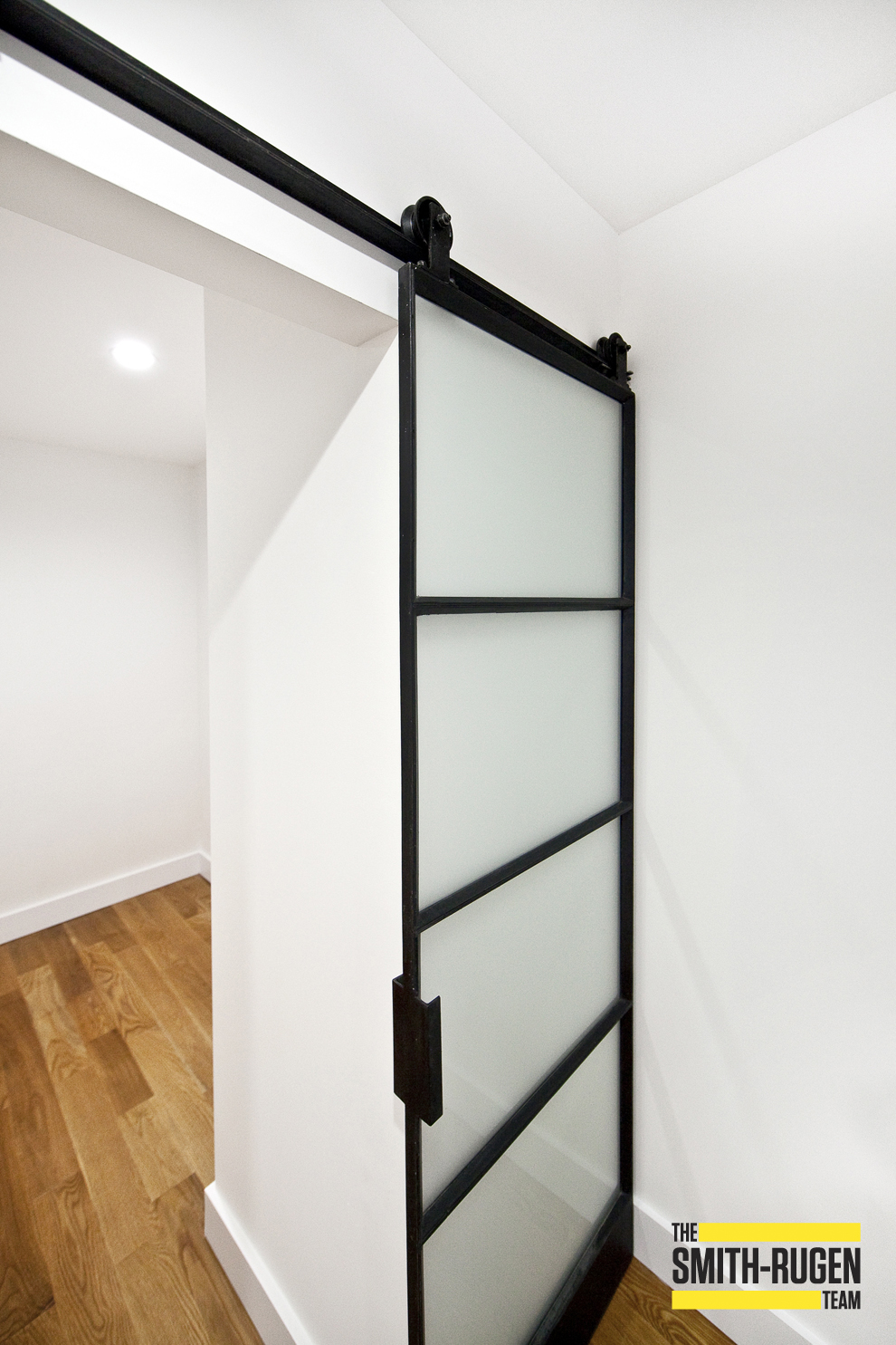 warehouse style door with opaque glass and bottom toe kick