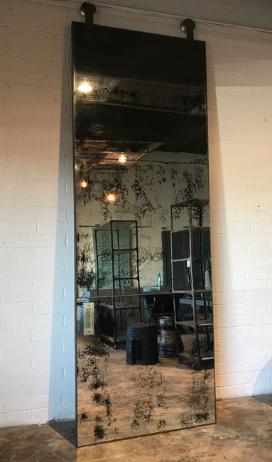 large antique barn door with brass seams