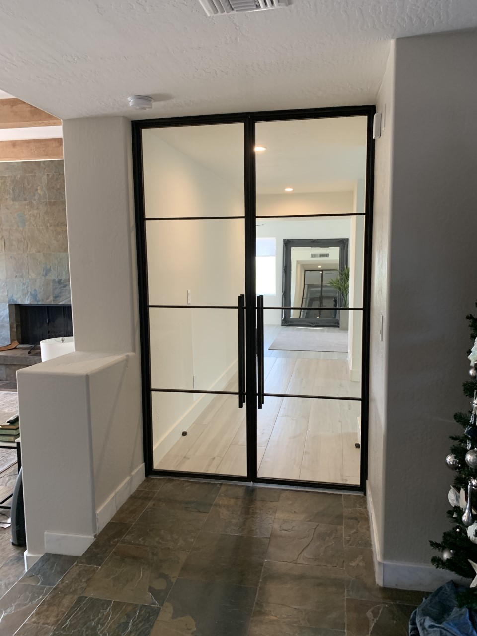 custom contemporary hinged metal and clear glass double doors