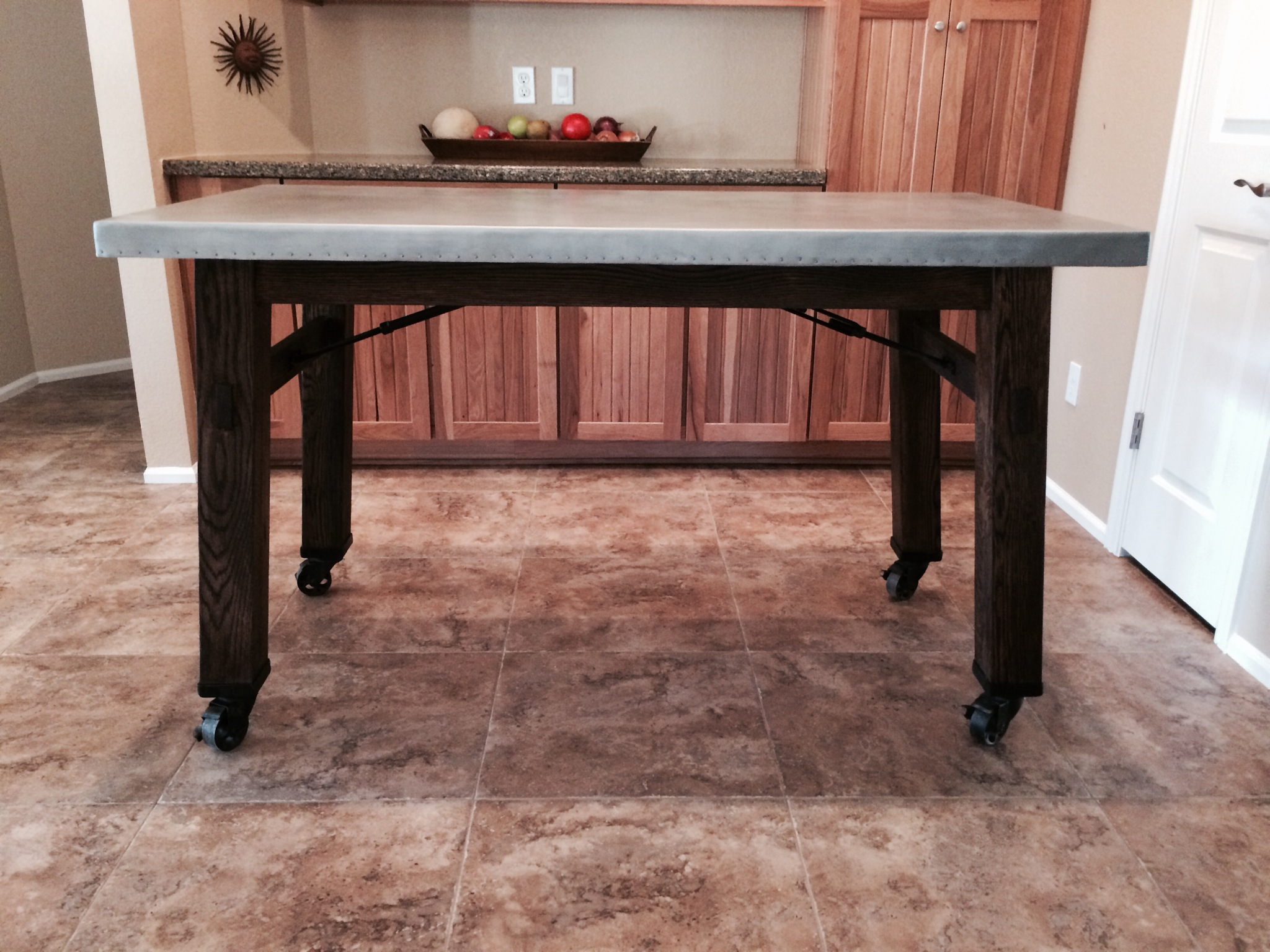 zinc table top with wood legs and casters